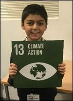 "RCE-EM2 Boy holding a sign which reads ""Climate action"""