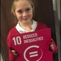 "RCE-EM3 Girl holding a sign which says ""Reduced Inequalities"""