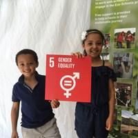 "Global Goals 2017 - 6 Boy and girl smiling and holding up a sign which reads ""Gender equality"""
