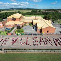 Spelling out we love clean air at Glebelands Primary School Children at Glebelands Primary School spelling out we love clean air - Clean Air Day 2018