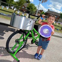Young boy proud of his spin art plate  Young boy proud of his spin art plate made on the Sustrans spin art bike