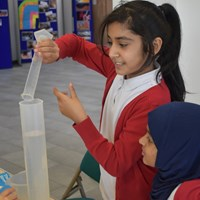 English Martyrs 2 Child from English Martyrs School pouring water into a graduated cylinder