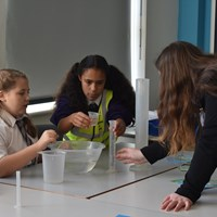 Fullhurst 12 Group of children working together on an experiment