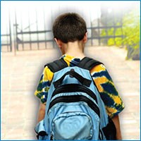 Bullying in our community - leaflets and guides Lonely school boy with his back turned